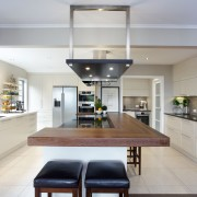 Coffee colours and natural woodgrains bring an inviting, countertop, interior design, kitchen, real estate, gray