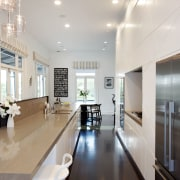 The handleless push-to-open latches on the rear wall ceiling, floor, flooring, interior design, kitchen, real estate, gray