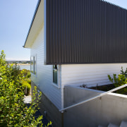 The Palliside cladding system works well with all architecture, building, corporate headquarters, daylighting, facade, home, house, real estate, residential area, roof, siding, sky, black, teal