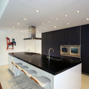 This kitchen designed by Nestor Santa-Cruz features a countertop, interior design, kitchen, real estate, room, gray, white