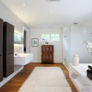 This master bathroom, designed by Nestor Santa-Cruz, continues bathroom, ceiling, floor, home, interior design, living room, real estate, room, white, gray