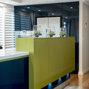 A green cabinet on the island offers storage architecture, cabinetry, ceiling, countertop, interior design, kitchen, gray