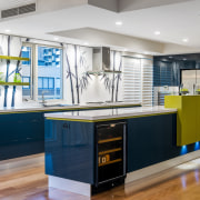 A custom backpainted glass splashback featuring bamboo plants countertop, interior design, kitchen, real estate, gray