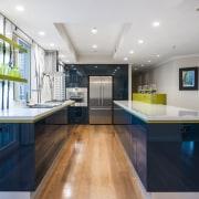 This two-tone design by designer Kim Duffin celebrates ceiling, countertop, interior design, kitchen, real estate, room, gray