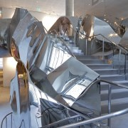 Crumpled polished stainless steel forms the balustrading on aerospace engineering, architecture, aviation, product design, structure, tourist attraction, gray