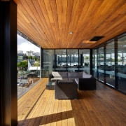 The new Ricoh office in Auckland features an apartment, architecture, balcony, daylighting, deck, home, house, interior design, penthouse apartment, real estate, roof, window, wood, brown, black