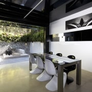 This new terrace house has a black and architecture, interior design, product design, table, black, white