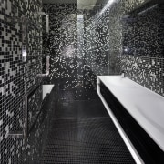 The black and white mosaic pattern in this architecture, black, black and white, design, flooring, light, monochrome, monochrome photography, reflection, structure, wall, black, gray