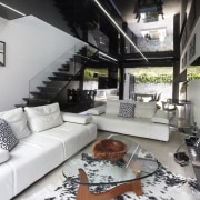 This new terrace house has a black and home, house, interior design, living room, loft, property, white, black, gray