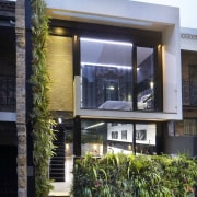 This sustainable house has vertical gardens integrated into architecture, building, condominium, facade, home, house, neighbourhood, real estate, residential area, window, black