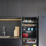 A bank of timber veneer cabinets in this home appliance, interior design, kitchen, product design, black, gray