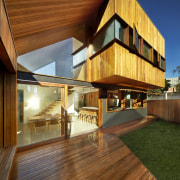 This contemporary extension to an Edwardian home includes apartment, architecture, daylighting, deck, estate, facade, home, house, interior design, real estate, residential area, siding, wood, brown