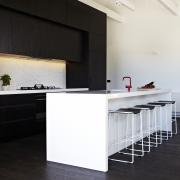 A crisp, monochromatic palette defines this new beach architecture, countertop, floor, flooring, furniture, house, interior design, kitchen, table, black, white