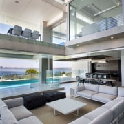 This new house by architect Anthony Rechichi is ceiling, interior design, yacht, gray