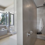 In the centre of this contemporary bathroom a architecture, bathroom, floor, home, interior design, property, real estate, room, gray