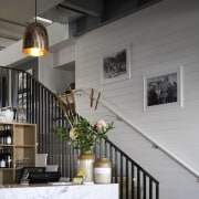 A Carrara marble counter draws on customary French apartment, architecture, building, facade, handrail, home, house, interior design, lobby, loft, stairs, wall, window, gray