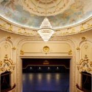 In the Isaac Theatre Royal restoration in Christchurch arch, architecture, ceiling, column, interior design, lobby, symmetry, theatre, tourist attraction, wall, orange