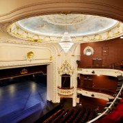 In the Isaac Theatre Royal restoration in Christchurch auditorium, ceiling, concert hall, interior design, lobby, opera house, performing arts center, theatre, orange