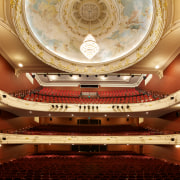 In the Isaac Theatre Royal restoration in Christchurch auditorium, concert hall, musical instrument accessory, opera house, performing arts center, theatre, orange, brown