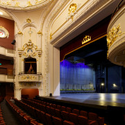 The restored Isaac Theatre Royal in Christchurch sits auditorium, ceiling, function hall, interior design, lobby, opera house, performing arts center, theatre, black, orange