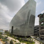 At the front, the Sandcrawler office building in architecture, building, corporate headquarters, facade, headquarters, sky, gray