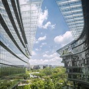 A roof canopy echoes the shape of the architecture, building, city, condominium, corporate headquarters, daytime, headquarters, landmark, metropolis, metropolitan area, mixed use, reflection, sky, skyscraper, tower block, urban area