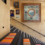 The young adults section of the Devonport Library carpet, floor, flooring, interior design, room, table, wood, orange