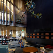 Comfortable seating and a gas fireplace near the architecture, interior design, lighting, lobby, black