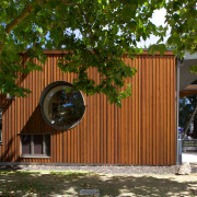 Cedar timber wraps around the exterior the new architecture, facade, home, house, outdoor structure, shed, siding, tree, brown
