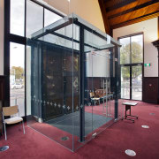 The entry to the rebuilt Knox Church in architecture, door, facade, floor, flooring, glass, house, interior design, structure, red