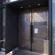 The entry to the rebuilt Knox Church in architecture, door, facade, glass, window, black, gray