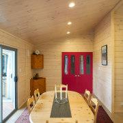 This new Lockwood, built by Lockwood Canterbury, is architecture, ceiling, dining room, floor, flooring, hardwood, home, house, interior design, living room, real estate, room, table, wall, wood, wood flooring, orange, brown