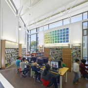 Soaring double-height ceilings in the childrens reading room classroom, daylighting, institution, library, library science, public library, white