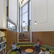 The adult reading area in North Beach Branch ceiling, classroom, daylighting, institution, interior design, room, gray, brown