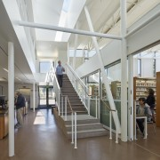 Exposed structural elements and services help to keep ceiling, daylighting, institution, interior design, library, library science, public library, gray