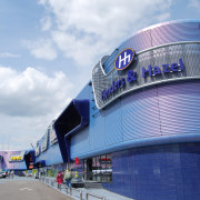 The Roermond Retail Park highlightd EuraMica Amethyst Purple architecture, blue, building, daytime, landmark, metropolitan area, sky, sport venue, stadium, structure, white