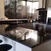 Before image of a  U-shaped kitchen that countertop, home appliance, interior design, kitchen, gray, black