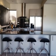 Before image of a  U-shaped kitchen that countertop, interior design, kitchen, real estate, gray