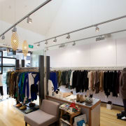 JNBY boutique occupies the third tenancy in a boutique, ceiling, interior design, retail, white