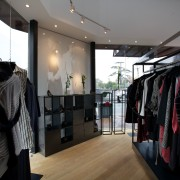 Taylor, a store on the corner of a boutique, interior design, retail, black, gray