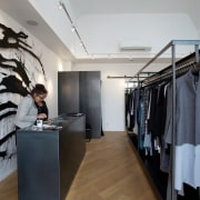 Taylor, a store on the corner of a boutique, fashion, interior design, product design, gray, black