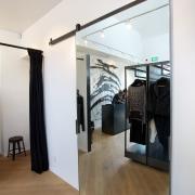 Soaring ceilings and skylights create light, airy store door, floor, flooring, interior design, loft, room, wood, white