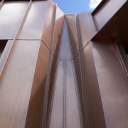 A copper cloak drapes and folds down this angle, architecture, building, daylighting, daytime, facade, line, sky, structure, gray