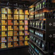 The new T2 store in Shoreditch London highlights grocery store, liquor store, product, retail, black