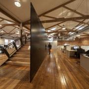 A former industrial warehouse in Melbourne is home ceiling, daylighting, floor, flooring, hardwood, interior design, laminate flooring, lobby, loft, real estate, wood, wood flooring, brown, orange