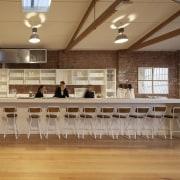 A former industrial warehouse in Melbourne is home ceiling, floor, flooring, function hall, furniture, hardwood, interior design, room, table, wood, wood flooring, orange, brown