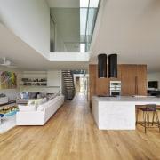 At 4m x 2m, this concrete island is floor, flooring, hardwood, interior design, kitchen, laminate flooring, living room, wood, wood flooring, gray