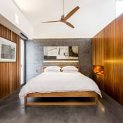Polished plaster walls, concrete floors and a rich architecture, bed frame, bedroom, ceiling, floor, interior design, real estate, room, suite, wall, wood, white, brown