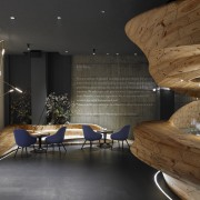 The centrepiece of Raw restaurant in Taipei is architecture, ceiling, floor, furniture, interior design, lobby, wood, black, brown