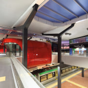 This curved red canopy in the new Butler leisure centre, sport venue, gray